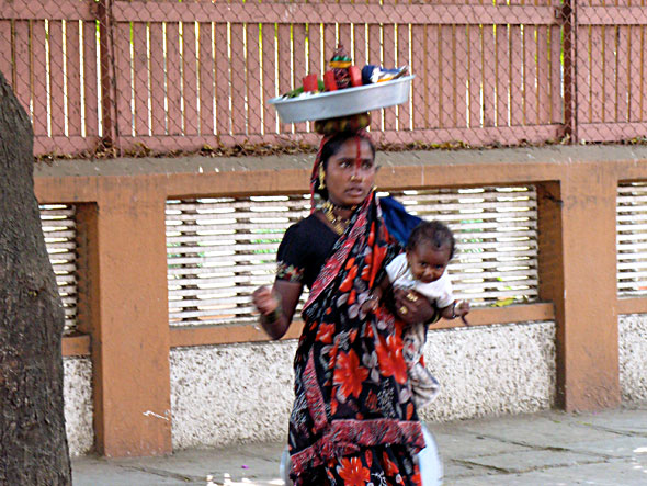 Outside the Institute, a tribal woman came to beg for money.